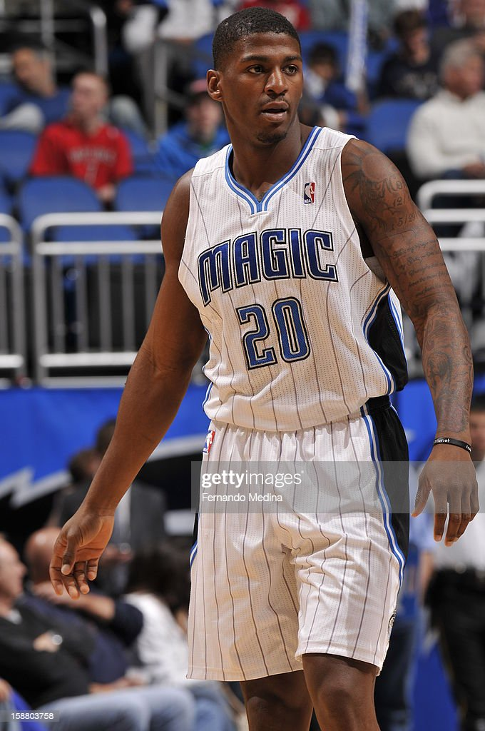 <a gi-track='captionPersonalityLinkClicked' href=/galleries/search?phrase=DeQuan+Jones&family=editorial&specificpeople=5626127 ng-click='$event.stopPropagation()'>DeQuan Jones</a> #20 of the Orlando Magic walks back after a break in play against the Toronto Raptors during the game on December 29, 2012 at Amway Center in Orlando, Florida.