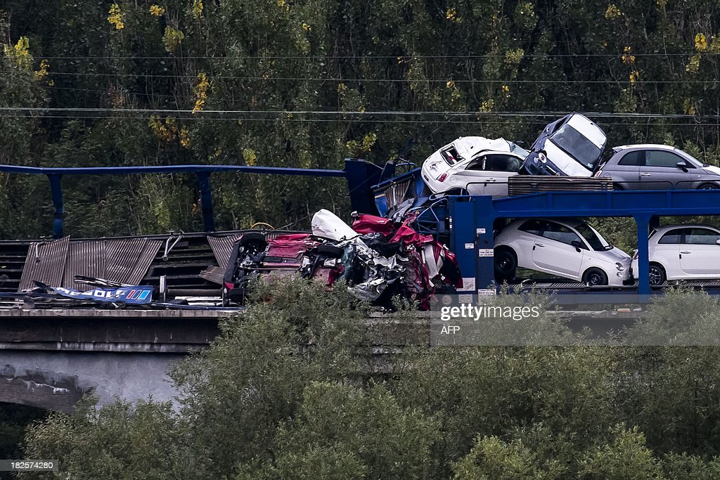 A derailed freight train, transporting Fiat cars, is pictured in Voeren on October 1, 2013. Three wagons fell off a bridge. Nobody got injured.