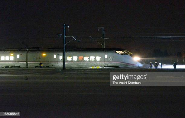Derailed Komachi 25 Akita Shinkansen bullet train is seen in the snow on March 2 2013 in Omagari Akita Japan Passengers were stuck for six hours in...