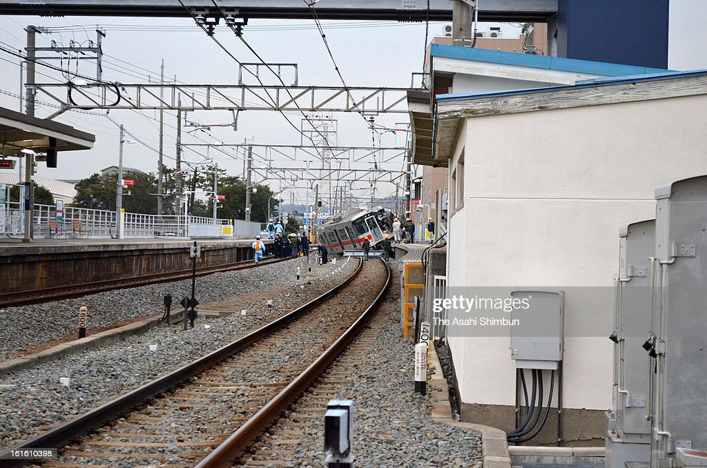 Derailed Sanyo Electric Railway Co. train is seen after a collision with a truck at Arai Station on February 12, 2013 in Takasago, Hyogo, Japan. Fifteen people injured by the accident.