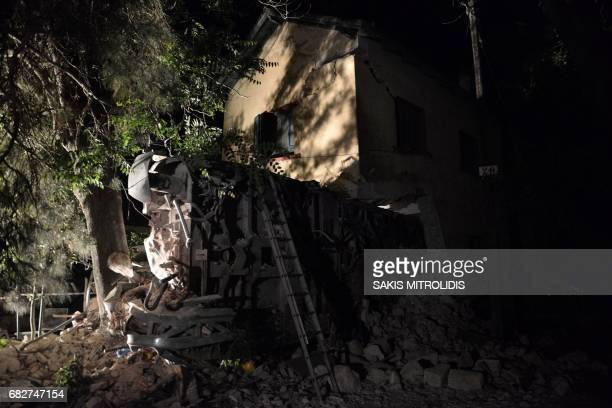 Derailed wagons from a train lie on the ground near the village of Adendro some 40 km west of Thessaloniki Northern Greece on May 14 2017 Two people...