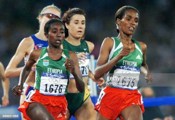 Derartu Tulu of Ethiopia and compatriot Gete Wami power over the track in the women's 10000m final 30 September 2000 at the Sydney Olympic Games to...