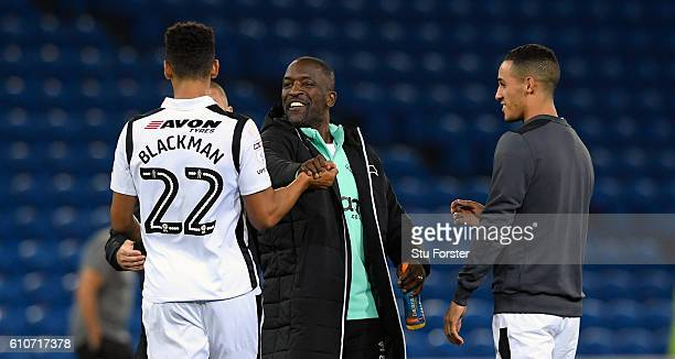 Derby coach Chris Powell congratulates his two goalscorers Nick Blackman and Tom Ince after the Sky Bet Championship match between Cardiff City and...