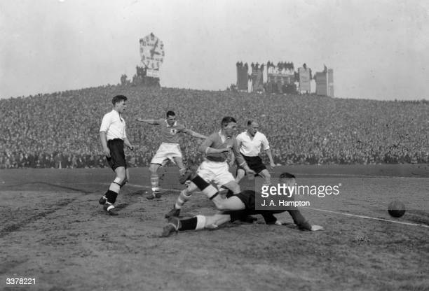 Derby County goalkeeper Scattergood makes a diving save as Millwall FC play Derby County FC in an FA Cup tie at the Den London 20th February 1937