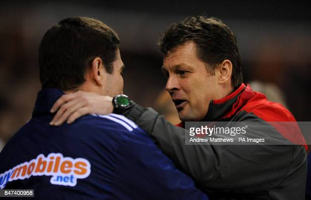Derby County manager Nigel Clough and Nottingham Forest manager Steve Cotterill during the npower Football League Championship match at Pride Park...