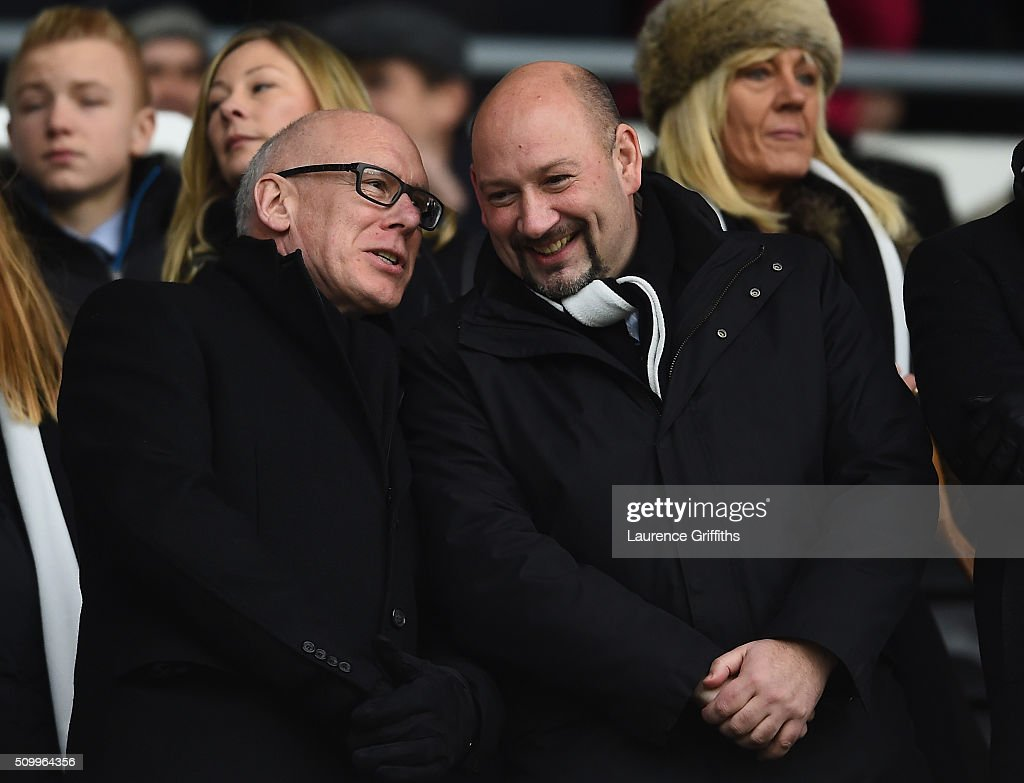 Derby County owner Mel Morris talks with President & Chief Executive Sam Rush during the Sky Bet Championship match between Derby County and Milton Keynes Dons at iPro Stadium on February 13, 2016 in Derby, United Kingdom.