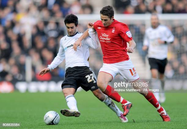 Derby County's Alberto Bueno and Nottingham Forest's Chris Cohen battle for the ball