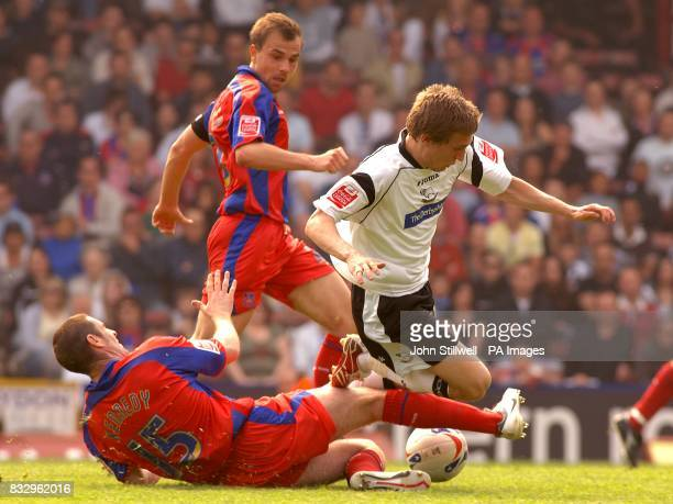 Derby County's Arturo Lupoli and Crystal Palace's Mark Kennedy battle for the ball