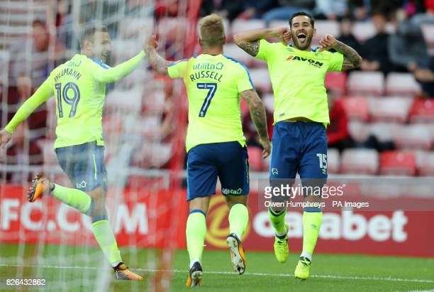 Derby County's Bradley Johnson celebrates scoring his side's first goal of the game with team mates during the Sky Bet Championship match at the...