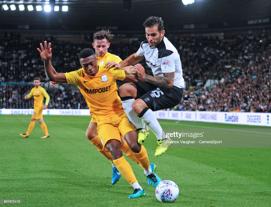 Derby County's Bradley Johnson is tackled by Preston North End's Darnell Fisher during the Sky Bet Championship match between Derby County and Preston North End at Pride Park Stadium on August 15, 2017 in Derby, England.