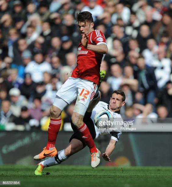 Derby County's Craig Bryson and Nottingham Forest's Jamie Mackie battle for the ball during the Sky Bet Championship match at the iPro Stadium Derby