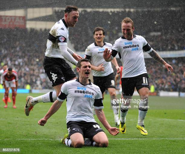 Derby County's Craig Bryson celebrates after scoring his third goal and his sides fifth goal of the game from the penalty spot with Richard Keogh and...