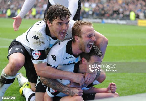 Derby County's Craig Bryson celebrates with Chris Martin and Johnny Russell after scoring his sides fifth goal of the game during the Sky Bet...