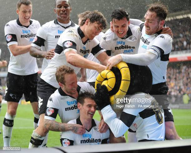 Derby County's Craig Bryson celebrates with his team mates after scoring his sides fifth goal of the game against Nottingham Forest during the Sky...