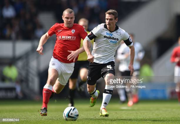 Derby County's Craig Bryson gets away from Barnsley's Stephen Dawson during the Sky Bet Championship match at the iPRO Stadium Derby