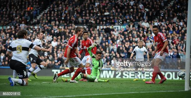 Derby County's Craig Bryson scores the opening goal during the Sky Bet Championship match at the iPro Stadium Derby