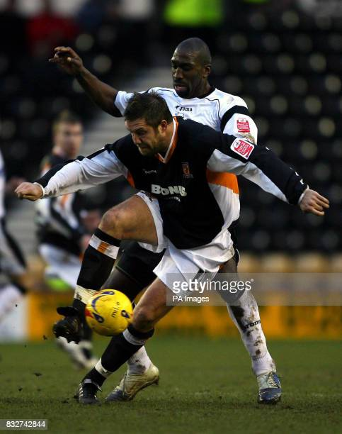 Derby County's Darren Moore and Hull City's Jon Parkin battle for the ball during the CocaCola Championship match at Pride Park Derby