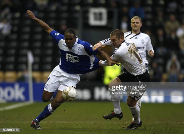 Derby County's Jake Buxton and Birmingham City's Cameron Jerome battle for the ball