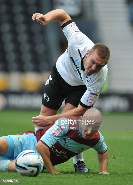 Derby County's Jake Buxton and Burnley's Martin Paterson in action