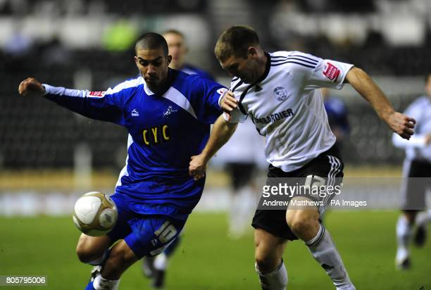 Derby County's Jake Buxton and Millwall's Lewis Graban battle for the ball during the FA Cup Third Round Replay at Pride Park Stadium Derby