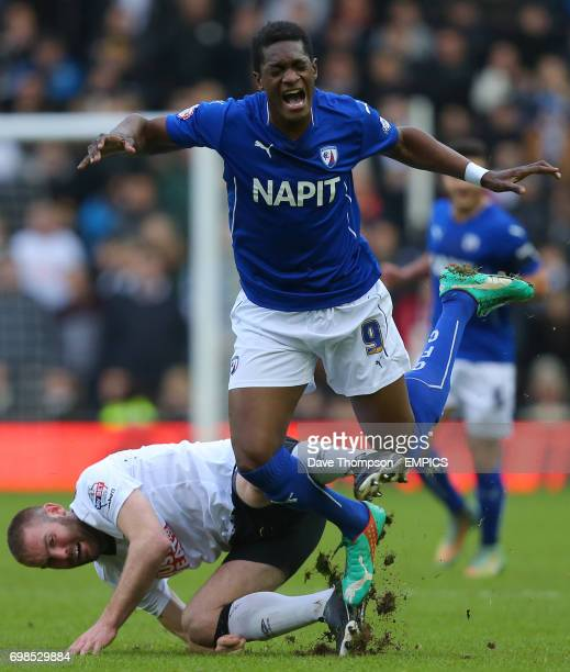 Derby County's Jake Buxton fouls Chesterfield's Armano Gnanduillet