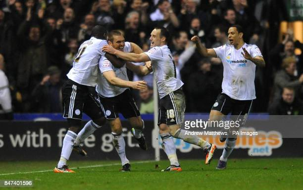Derby County's Jake Buxton is mobbed by his team mates after scoring the opening goal during the npower Football League Championship match at Pride...