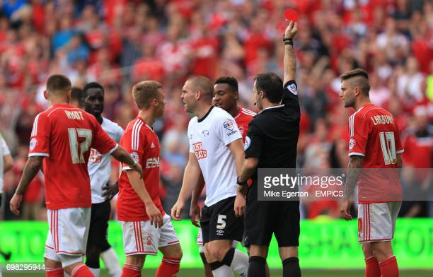 Derby County's Jake Buxton is shown a red card by referee Paul Tierney