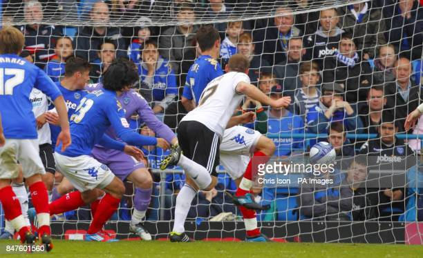 Derby County's Jake Buxton scores his sides opening goal during the npower Championship match at Fratton Park Portsmouth