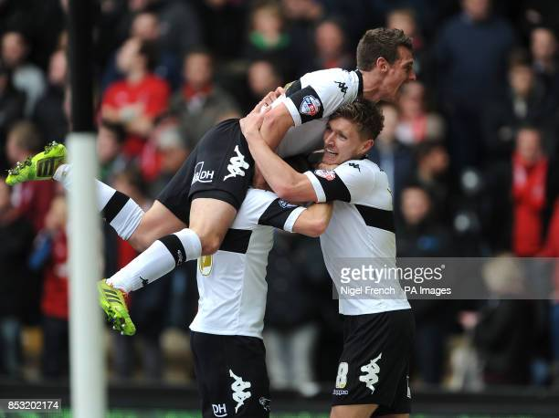 Derby County's Jeff Hendrick celebrates with Jamie Ward and Craig Bryson after scoring his sides third goal of the game during the Sky Bet...