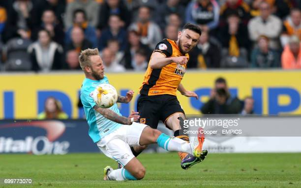 Derby County's Johnny Russell and Hull City's Robert Snodgrass battle for the ball