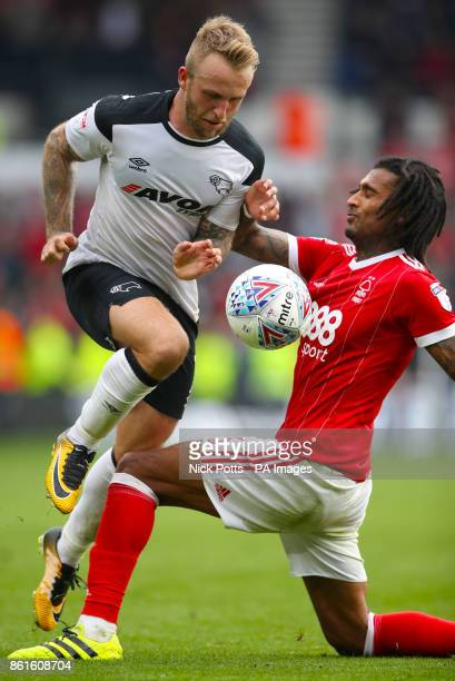 Derby County's Johnny Russell and Nottingham Forest's Armand Traore battle for the ball during the Sky Bet Championship match at Pride Park Derby