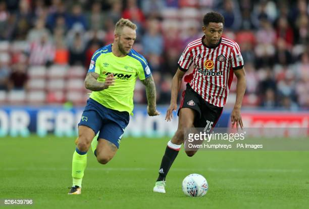 Derby County's Johnny Russell and Sunderland's Brendan Galloway battle for the ball during the Sky Bet Championship match at the Stadium of Light