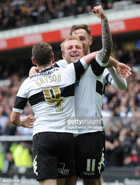 Derby County's Johnny Russell celebrates with Craig Bryson and Richard Keogh after scoring his sides fourth goal of the game during the Sky Bet...