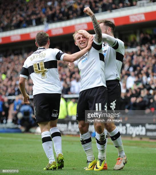 Derby County's Johnny Russell celebrates with Craig Bryson and Richard Keogh after scoring his sides fourth goal during the Sky Bet Championship...