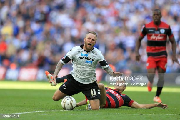 Derby County's Johnny Russell is fouled by Queens Park Rangers' Gary O'Neil to earn a red card
