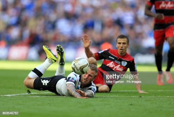 Derby County's Johnny Russell is fouled by Queens Park Rangers' Gary O'Neil