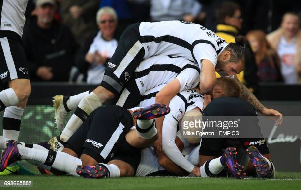 Derby County's Johnny Russell is mobbed after scoring their first goal