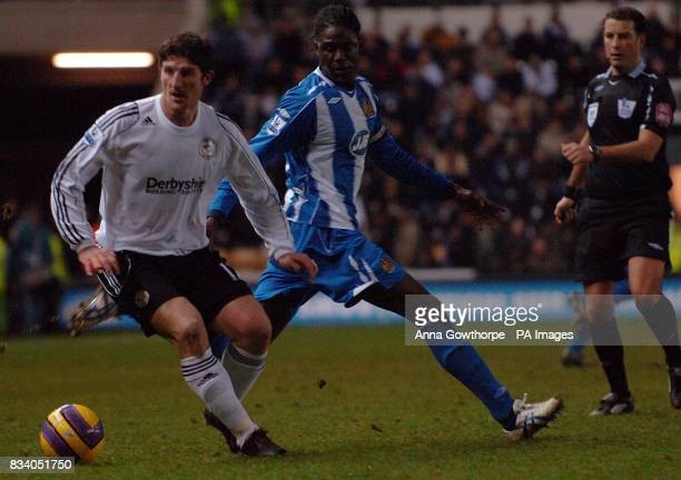 Derby County's Jonathan Macken and Wigan Athletic's Mario Melchiot Wigan Athletic's battle for the ball