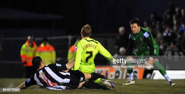 Derby County's Kris Commons is brought down by Forest Green's Darren Jones in the area to concede a late penalty as goalkeeper Terry Burton looks on...