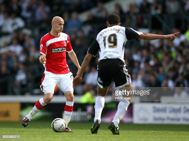 Derby County's Lewin Nayatanga and Charlton Athletic's Jonjo Shelvey during the CocaCola Championship match at Pride Park Derby