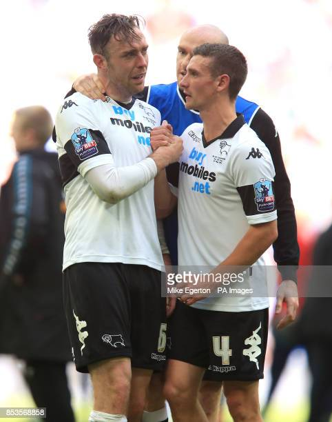 Derby County's Richard Keogh is consoled by Craig Bryson