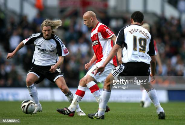 Derby County's Robbie Savage and Lewin Nyatanga close down Charlton Athletic's Jonjo Shelvey during the CocaCola Championship match at Pride Park...