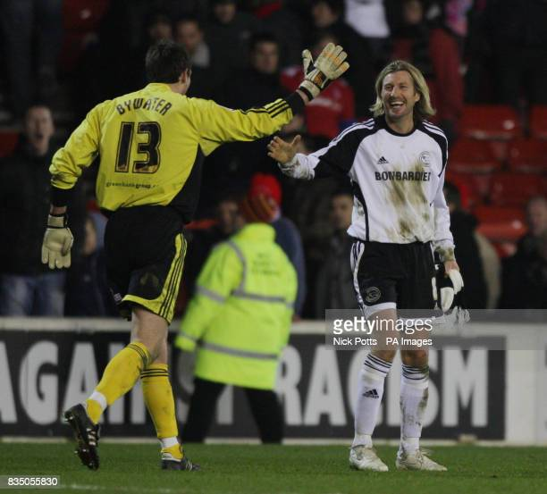 Derby County's Robbie Savage and Stephen Bywater celebrate their victory following the FA Cup Fourth Round Replay at the City Ground Nottingham