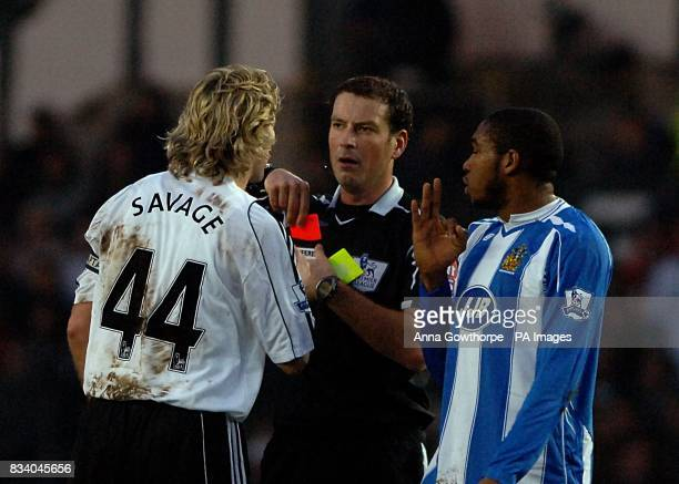 Derby County's Robbie Savage discusses the red card given to his team mate Claude Davis with referee Mark Clattenburg