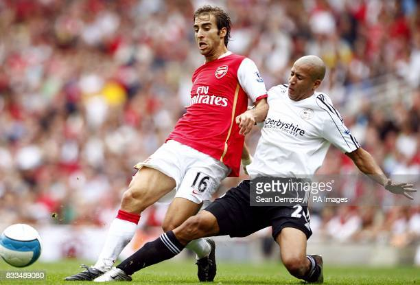 Derby County's Tyrone Mears and Arsenal's Mathieu Flamini battle for the ball