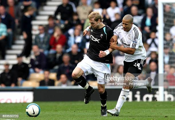 Derby County's Tyrone Mears and Bolton Wanderers' Christian Wilhelmsson battle for the ball