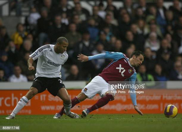 Derby County's Tyrone Mears and West Ham United's Matthew Etherington battle for the ball