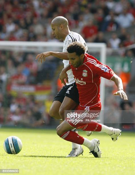 Derby County's Tyrone Mears fouls Liverpool's Jermaine Pennant as they battle for the ball