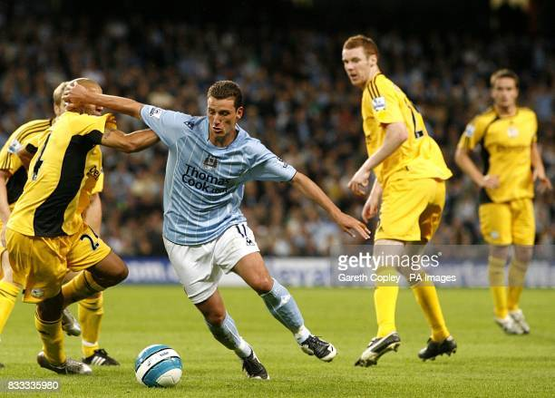 Derby County's Tyrone Mears is beaten by Manchester City's Blumer Elano