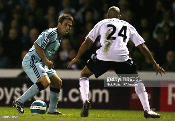 Derby County's Tyrone Mears keeps an eye on Newcastle United's Michael Owen